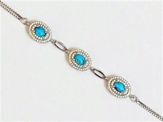 دستبند نقره فیروزه نیشابور طرح سه نگین جواهری با نگین زیرکونیا و روکش طلا سفید