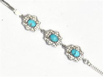 دستبند نقره فیروزه نیشابور طرح گل جواهری با نگین های زیرکونیا آبکاری طلا سفید